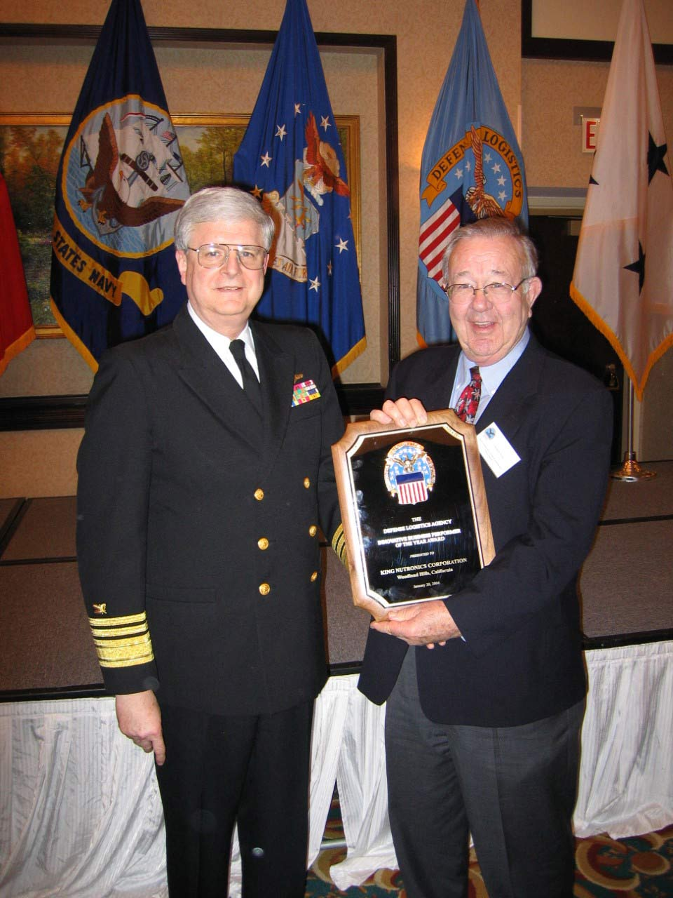 Bob King accepts DLA 2004 Defense Logistics Award from U.S. Navy Vice Admiral Keith W. Lippert